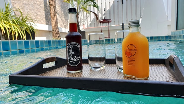 minibar drinks floating on pool